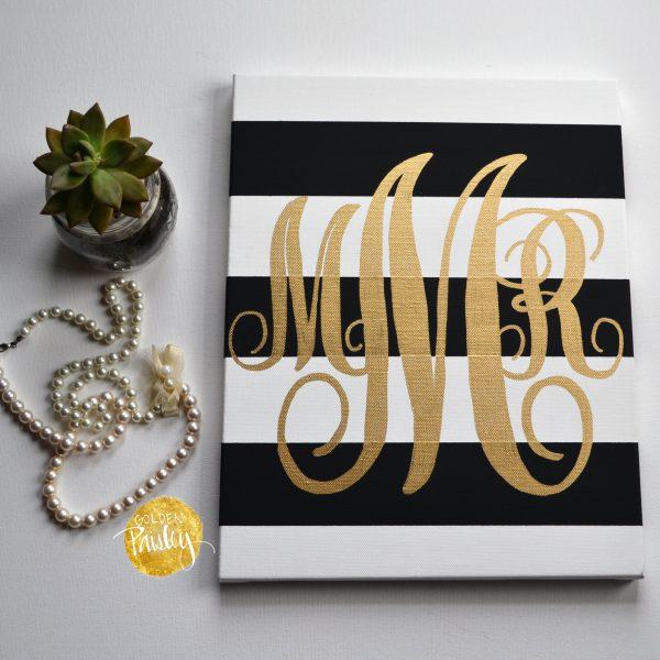 monogram black and gold striped canvas art