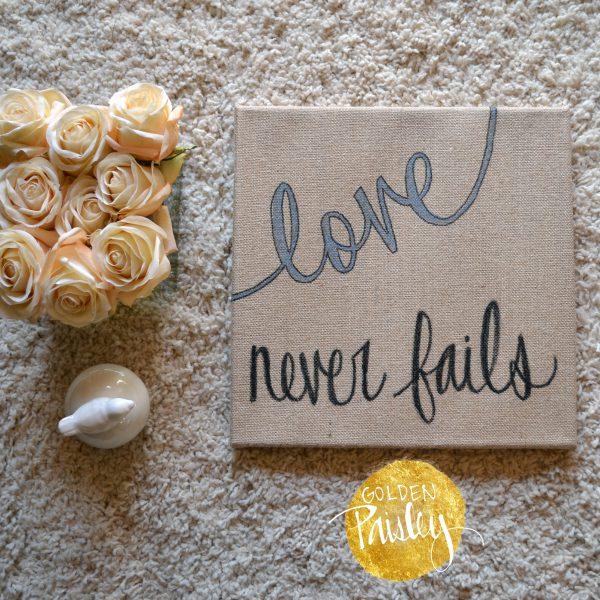 love never fails burlap wall hanging